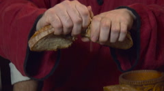Breaking the Piece of Bread Into Halves. Closeup Stock Footage