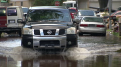 Truck driving through water Stock Footage