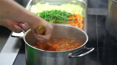 Closeup of chef mixing spoon soup on the plate Stock Footage