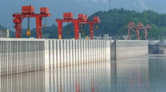 Three gorges dam, Yichang, China - long shot zoom of dam walls lake side Stock Footage