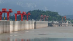 Three gorges dam, Yichang, China - long shot zoom of dam walls lake side with di Stock Footage