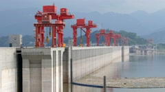 Three gorges dam, Yichang, China - Medium wide view from side with red crane tow Stock Footage