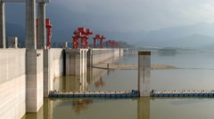 Three gorges dam, Yichang, China - Wide angle view from side with red crane towe Stock Footage