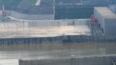 Three gorges dam, Yichang, China - long shot of sluice canals outlet below dam Stock Footage