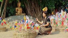 Woman pinned traditional flags on sand pagoda in Songkran festival , Chiang mai Stock Footage