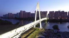 Pedestrian cable bridge in modern Moscow. Unique sunset evening aerial drone sho Stock Footage