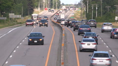 Traffic and vacation cars heading to cottage country for long holiday weekend Stock Footage