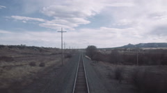 Train travel through rural countryside United States - stock footage