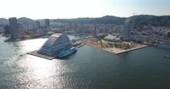 Circling aerial shot of kobe harbour Japan Stock Footage