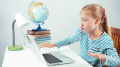 Schoolgirl using her laptop something typing and dancing Stock Footage