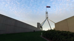 4k Tracking shot of Australian Parliament House towards curved wall at Dusk Stock Footage