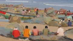 Busy scene on beach with fishermen repairing nets,Konark,India Stock Footage