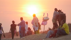Indian tourists on beach at sunset,Konark,India Stock Footage