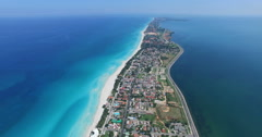 Drone flies over tropical island in the Atlantic Ocean. Bird's-eye view to main Stock Footage