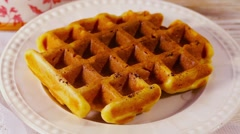 Belgian waffles with kiwi and orange pour syrup Stock Footage