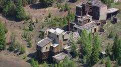 Abandoned Mine Buildings On Hillside Stock Footage