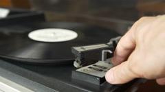Man's hand starts vinyl recorder, drops stylus Stock Footage