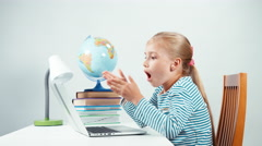 Child shocked by the information from the Internet. Isolated on white - stock footage