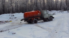 Vacuum Truck Moving Offthe Dumping Ground by the Forest Stock Footage