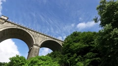 Facing upward perspective of driving under tall Railway bridge in Newquay. Stock Footage