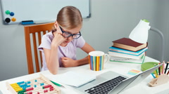 Portrait student girl 7-8 years using abacus in her desk at home Stock Footage