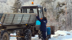 Tractor Driver Adjusting the Trailer in the Forest Stock Footage