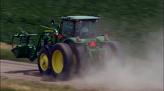 Following A Tractor On A Dirt Road Stock Footage