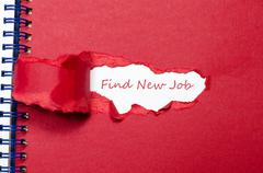 The word find new job appearing behind torn paper Stock Photos
