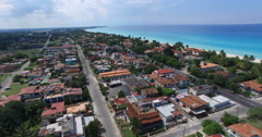 Bird's-eye view to main streets, houses and hotels of Varadero. Drone is flying Stock Footage