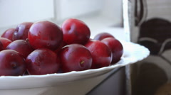Red Plums On The White Plate Stock Footage