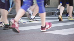 Marathon runners, feet close-up, 20 seconds Stock Footage