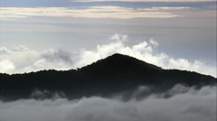 Clouds Banked Up Against Mountain Ridge Stock Footage