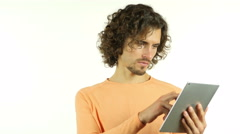 Man with Curl Hairs Browsing Online on Tablet Stock Footage
