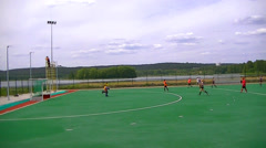 Boys and girls playing field hockey Stock Footage
