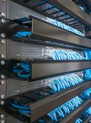 Ethernet network switch and network wire in rack cabinet Stock Photos