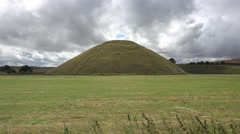 Silbury Hill, a prehistoric artificial chalk mound near Avebury, Wiltshire, UK. Stock Footage