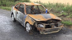 A burnt out abandoned car in Wiltshire, UK. Stock Footage