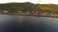 Sunrise in Amed on the beach, aerial shot Stock Footage