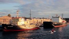 Small Speed-boat Swim Beside Two Big Icebreakers Stock Footage
