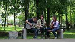A group of young street musicians learning  Stock Footage