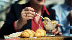Woman hands eating muesli in cafe Stock Footage