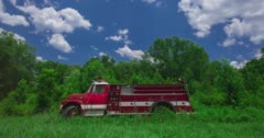 Old Model Red Firetruck In Green Field With Blue Sky Stock Footage