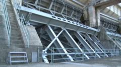 Tainter gate from river hydroelectric dam Stock Footage