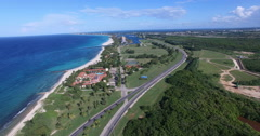 Drone moves down to an inscription Varadero. Bird's-eye view above tropical Stock Footage