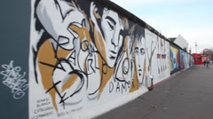 Tourist in the Berlin Wall in Berlin Germany Stock Footage