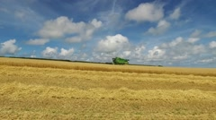 Combine harvester harvesting ripened wheat in field Stock Footage