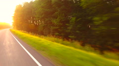 A car traveling on the road view from the window the trees with sunlight. Stock Footage