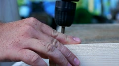 Man twists the screws using a screwdriver in a wooden frame Stock Footage