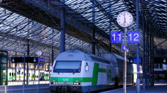A passenger train arrives at the railway station in Helsinki, Finland. Time Laps - stock footage