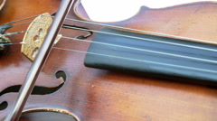 Violinist playing the violin on white background. Close up, isolated. 4K Stock Footage